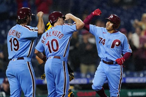 Phillies rally from 6 down, beat Bucs 12-6 to gain on Braves