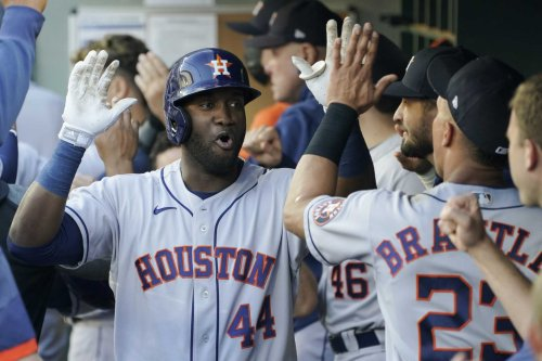 Astros bounce back, hold off Mariners to cap busy day