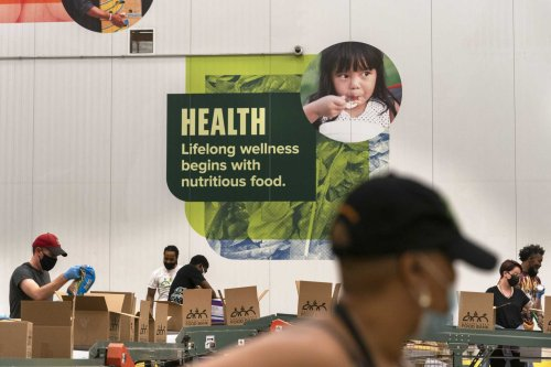 The Latest: Food bank needs still above pre-pandemic levels