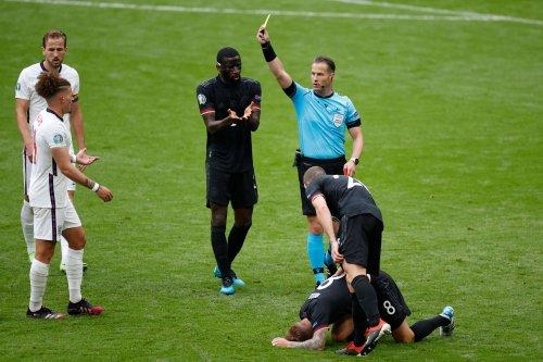 How far do referees run in a football match?