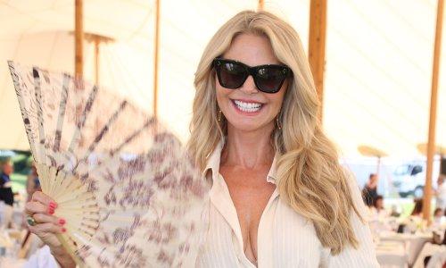 Christie Brinkley drives fans wild in silky blue negligee