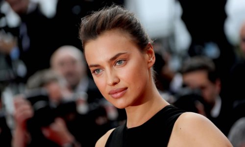 Irina Shayk flashes her sculpted abs in a crop top we want right now