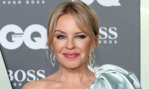 Kylie Minogue looks incredible in feathered mini dress as fans react