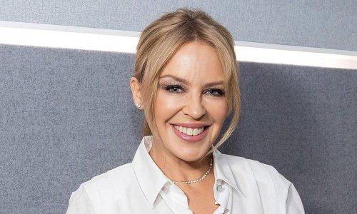 Kylie Minogue stuns in denim mini skirt and boyfriend's shirt following return to UK