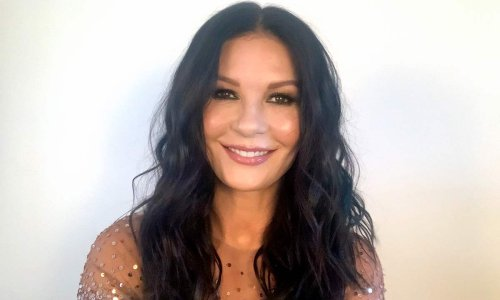 Catherine Zeta-Jones stuns in dramatic lace gown in celebratory photo with rarely seen brother