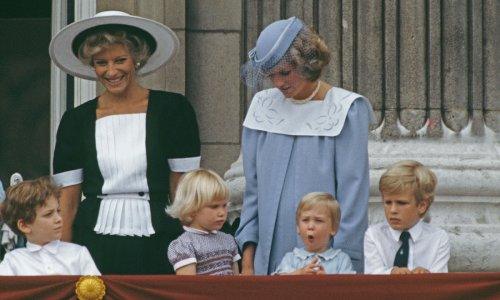 Watch Princess Diana's reaction as Zara Phillips gives Prince William a kiss on the balcony - video