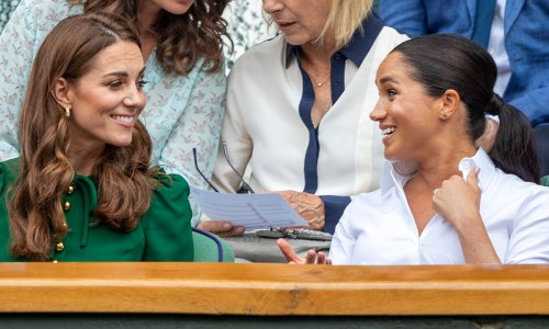 Meghan Markle poses with magazine cover featuring her now sister-in-law Kate Middleton