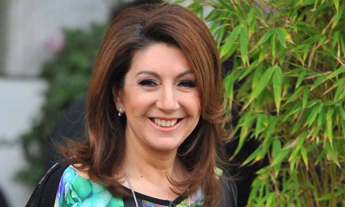 Jane McDonald looks stunning in check coat as she hints at exciting news