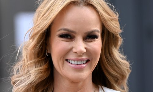 Amanda Holden wows in bold bikini as she jets off for family holiday