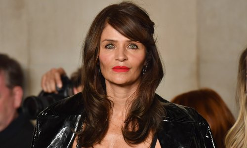 Helena Christensen performs quirky workout in stunning black swimsuit
