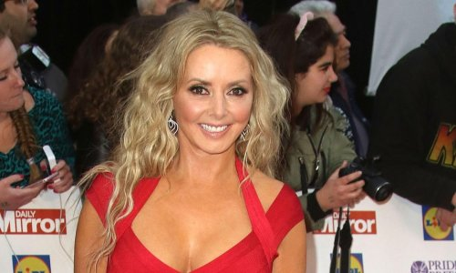 Carol Vorderman shows off incredible curves in red swimsuit