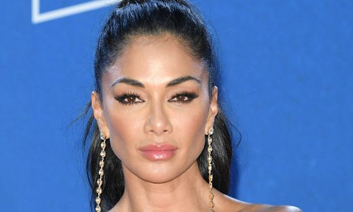 Nicole Scherzinger delivers another must-see look with incredible purple outfit