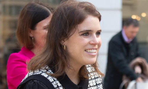 Princess Eugenie wears mini dress and knee-high boots at art exhibition
