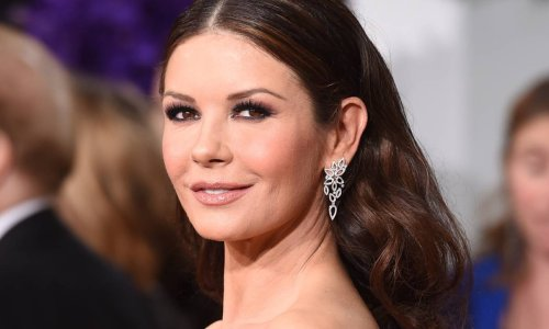 Catherine Zeta-Jones commands attention as she poses in robe inside family kitchen