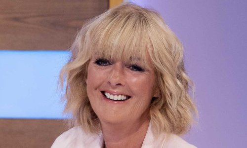 Jane Moore styles flirty rainbow dress in most unexpected way