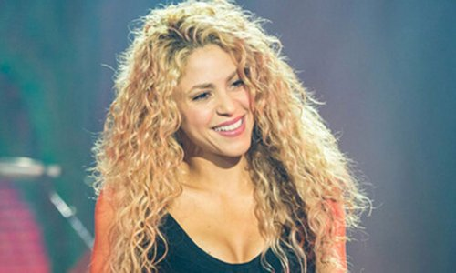Shakira sends pulses racing in backless sparkly dress with daring thigh split