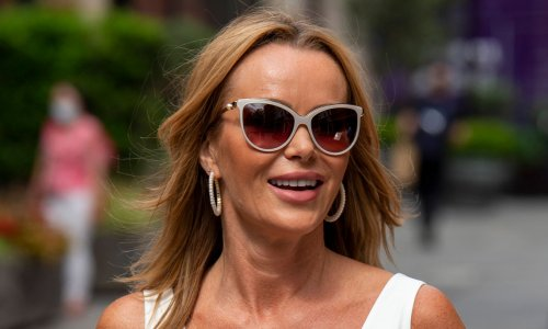 Amanda Holden poses in all-white for candid hotel room snap