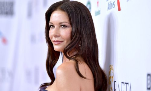 Catherine Zeta-Jones stuns in sparkling dress in extremely rare photo with her parents