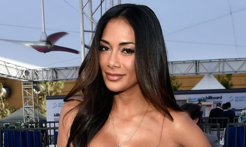 Nicole Scherzinger turns some serious heads with new waterside video