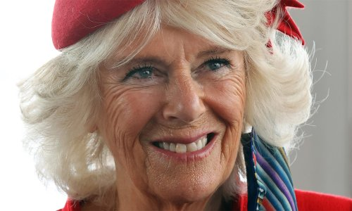 Duchess Camilla is sensational in red alongside The Queen and Prince Charles
