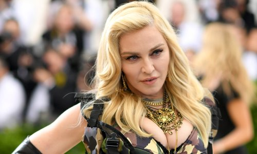 Madonna poses up a storm in a corset and ripped jeans in sensational photo