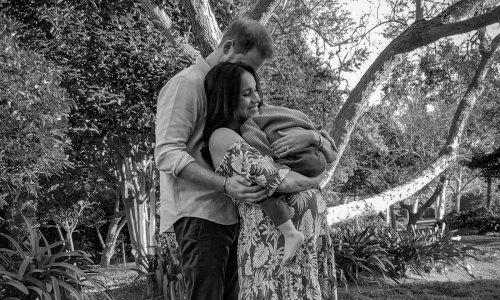 Prince Harry and Meghan Markle cradle Archie and baby bump in new adorable pic