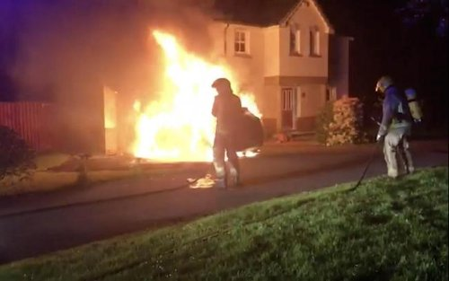Tory councillor's home and cars torched in third attack on politician