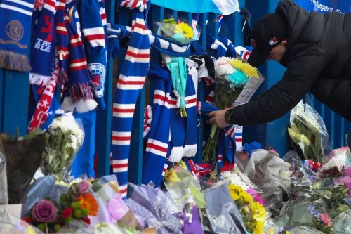 'It feels like I've lost a family member': Fans from both sides of the Old Firm gather outside Ibrox to mourn death of Walter Smith