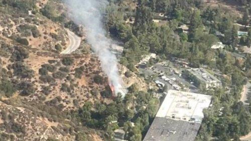 Pasadena firefighters battle brush fire near Art Center