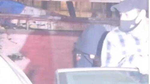 Shah Rukh Khan hides face under a hoodie as paparazzi spot him, son Aryan Khan. Watch