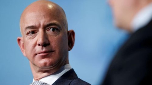 In Jeff Bezos' letter, mention of a couple that bought 2 shares of Amazon in 1997
