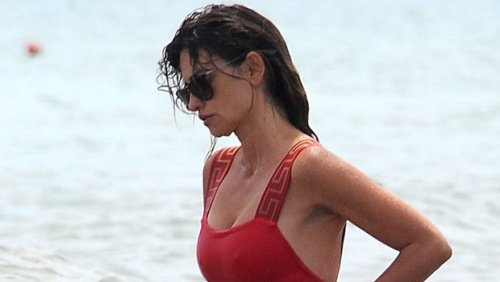 Penelope Cruz, 47, Rocks Sexy Red Swimsuit & Ripped Daisy Dukes At The Beach In Italy – Photos