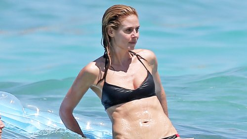 Heidi Klum, 48, Sunbathes On A Boat In Stunning Purple Bikini — Photos