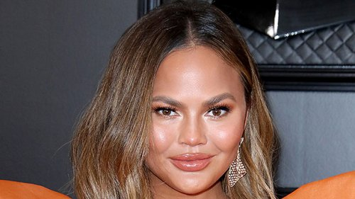 Chrissy Teigen Reveals Scars After Having Breast Implants Removed Last Year — Watch