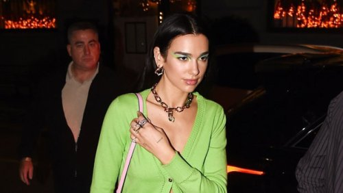 Dua Lipa Wears Miniskirt & Sweater With Nothing Underneath For Dinner With Gigi Hadid After Runway Debut