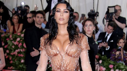 Kim Kardashian Stuns In Nude-Colored Thong As She Sips Diet Coke In New KKW Beauty Photos