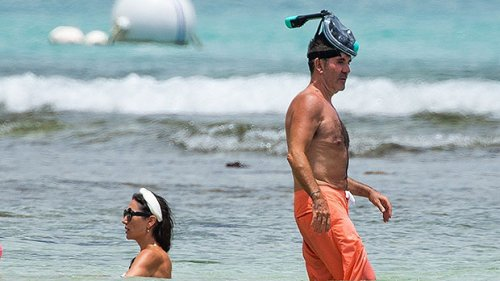 Simon Cowell, 60, Looks Buff As He Goes Shirtless On The Beach With Son Eric, 7, & Lauren Silverman