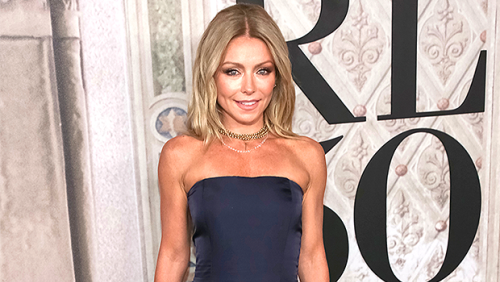 Kelly Ripa Wears Black Swimsuit & Wades In The Ocean In Throwback Vacation Pic