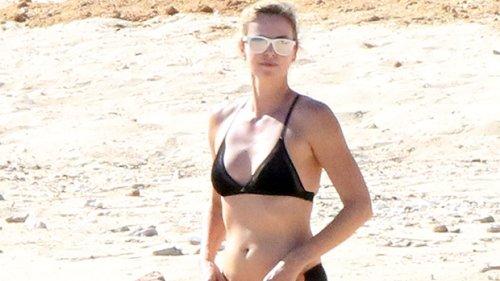 Charlize Theron, 45, Rocks A Black Bikini While Hitting A Luxury Yacht In Greece — Photos