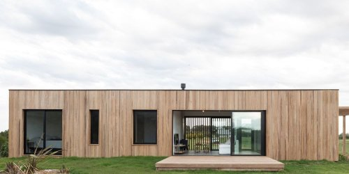 Modern Wooden House That Weathers Naturally And Blends With The Landscape