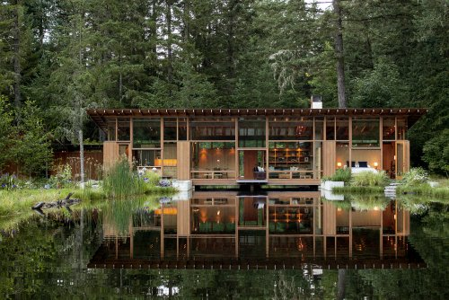 Nature-inspired Residence Built Over A Pond