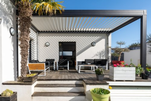 A Retractable Pergola Shade Adds Privacy and Character To Your Outdoor Living Area