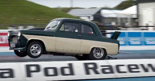 Watch This Street-Legal 1950s Ford Pop Wheelies And Run 8s