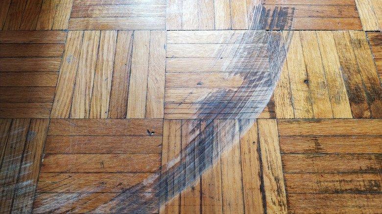 Inexpensive Ways To Fix The Huge Scratch In Your Wood Floor