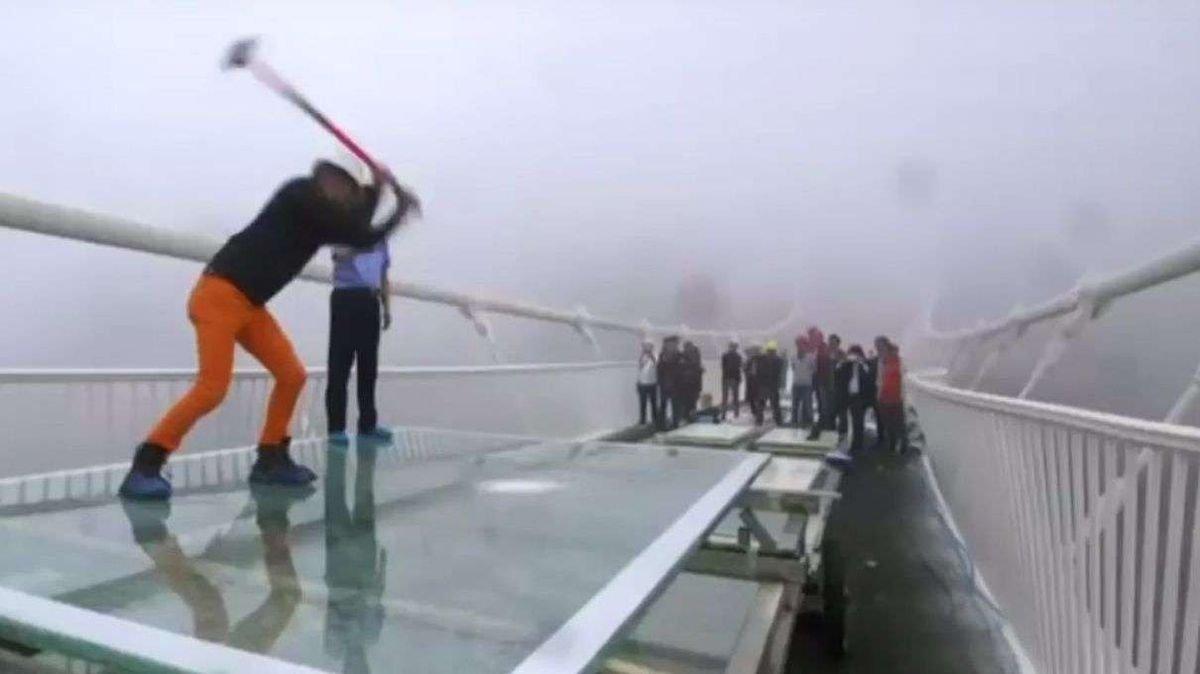 Watch the World's Highest Glass Bridge Get Sledgehammered