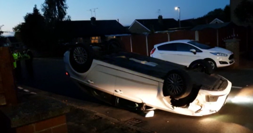 Driver injured after car flips over in two vehicle smash