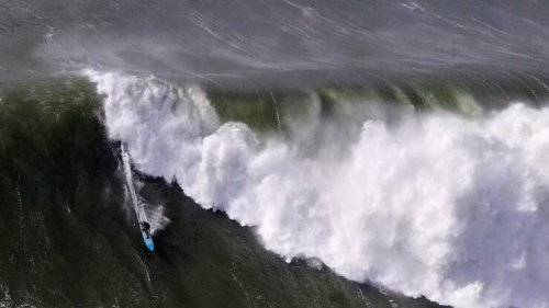 Peter Mel drops in on A 50 ft MONSTER WAVE for a ride at Mavericks!