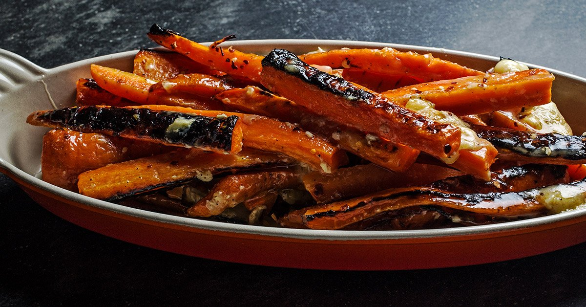 Carrots Covered In Brie Will Be Your New Go-To Side Dish