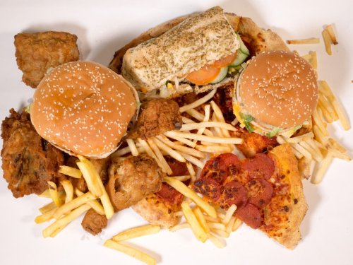 Ministers to 'ban junk food adverts on TV or online before 9pm'