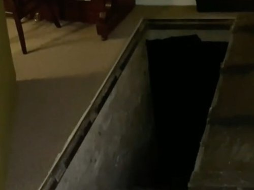 Man finds trapdoor in Airbnb that leads to 'swamp' below
